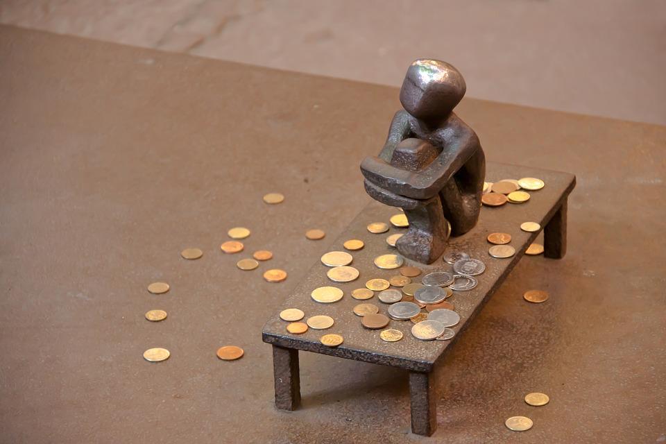 soška a mince